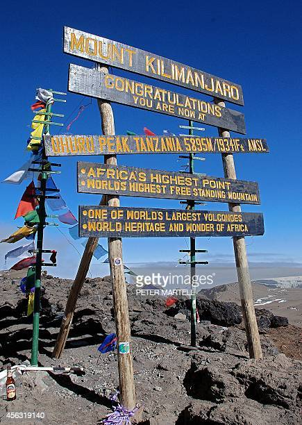 The sign at the peak of Mount Kilimanjaro Tanzania on September 26 2014 Mount Kilimanjaro is a dormant volcanic mountain in Tanzania It is the...