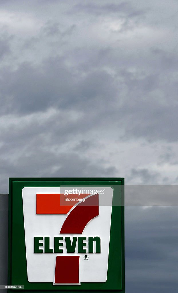 The sign for 7-Eleven stands outside the store in Sydney, Australia, on Monday, May 24, 2010. 7-Eleven Australia is close to acquiring most of Exxon Mobil Corp's local filling stations, the Australian newspaper reported on its website on May 19, without saying where it got the information. Photographer: Ian Waldie/Bloomberg via Getty Images