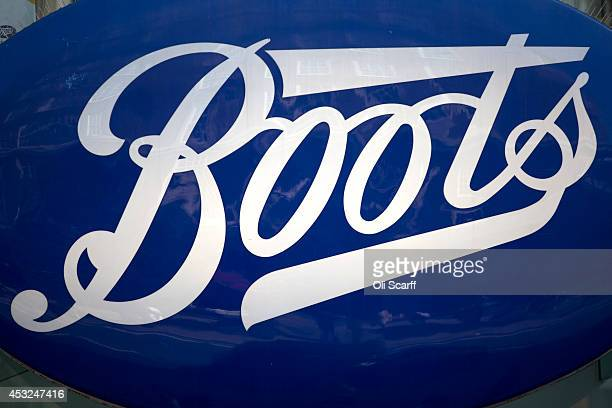 The sign for a branch of Boots the chemist on Oxford Street on August 6 2014 in London England US pharmacy chain 'Walgreens' who previously owned 45%...
