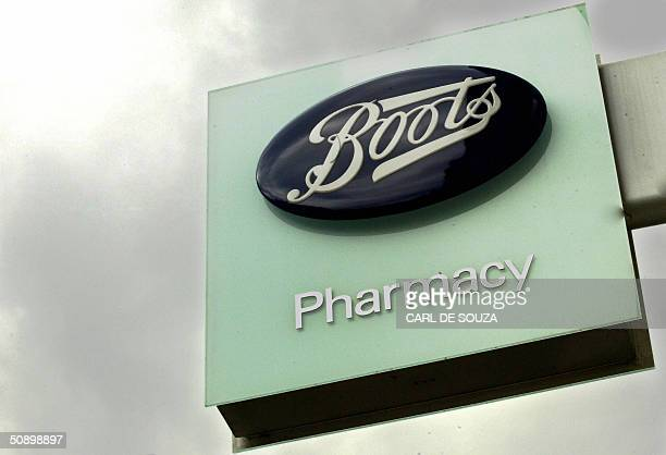The sign for Boots pharmacy is shown 26 May 2004 in London WH Smith Boots pharmacy and Marks Spencer are facing difficult times due to changes in...