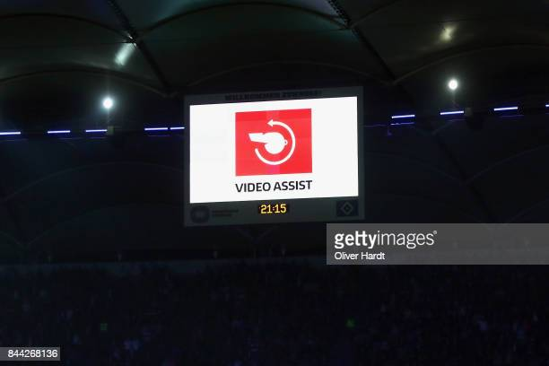 The sign for the Video Assistant referee is seen on the screen as referee Deniz Aytekin takes back a penalty during the Bundesliga match between...