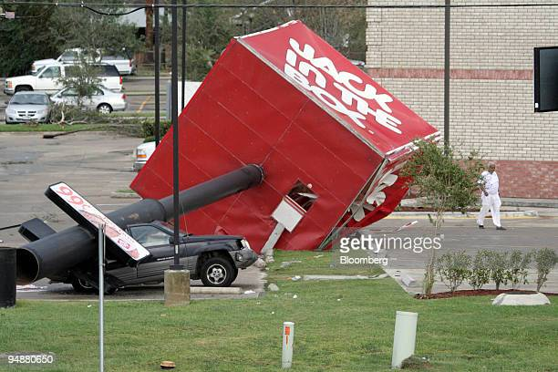 The sign from a Jack In The Box restaurant crashed down on a car in a motel parking lot during Hurricane Rita early Saturday in Beaumont Texas...