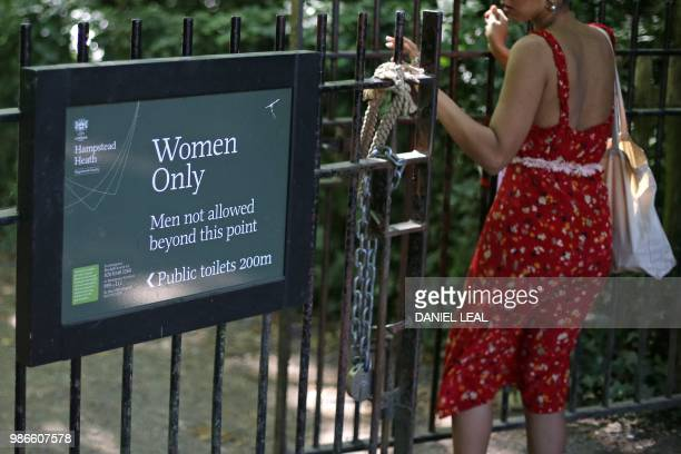 The sign indicating the 'Women Only' swimming pool is seen attached to gates on Hampstead Heath in central London on June 27 2018 Can transgender...