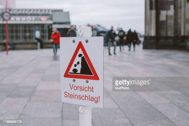 The sign is seen 'caution of falling rocks' in front of Dom catherlic on February 9 2020 in Cologne Germany