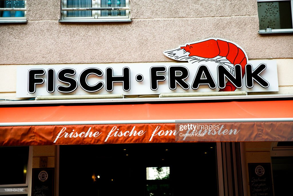 The sign of at Fisch Frank fish restaurant shows hin the symbol a ...