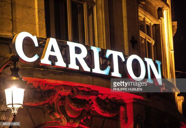 The sign of the Carlton Hotel is lit up in Lille on January 30 2015 As part of the probe into Dominique Alderweireld or 'Dodo la Saumure' a convicted...