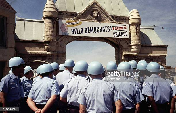 The sign over the archway leading to the International Amphitheater welcomes delegates to the Democratic Convention but from the sea of police...