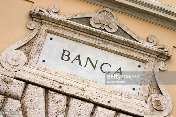The signage of an Italian Bank etched in marble