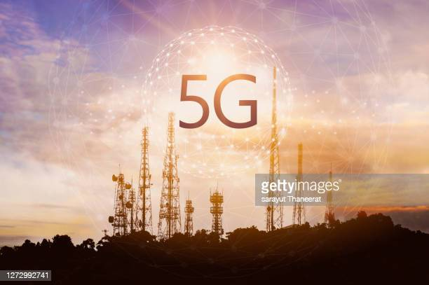 5g the signal poles are located on the mountain at sunset. - tower stock pictures, royalty-free photos & images