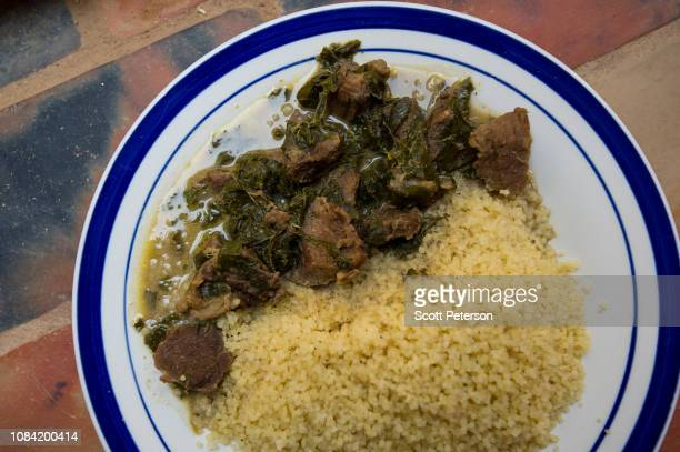 The signature dish of chef Abdoulaye Mahamane of camel meat with ground peanut and spinach sauce is served at the boutique hotel Auberge d'Azel on...