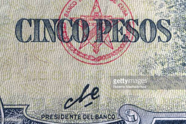The signature of Ernesto Che Guevara on a Five Cuban Pesos bill of 1960 He was the president of the Cuban Bank a year after the triumph of the...