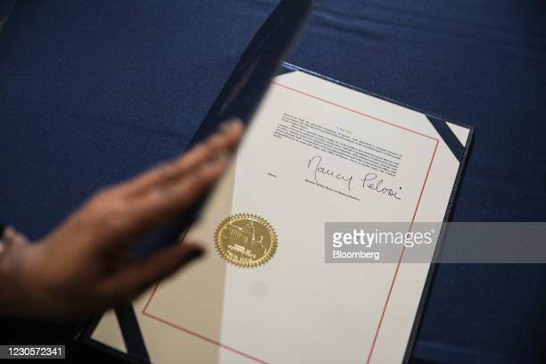 The signature of U.S. House Speaker Nancy Pelosi, a Democrat from California, on the articles of impeachment against President Donald Trump during an...