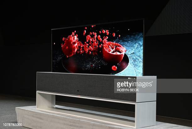 The Signature OLED TV R, a roll-up television, is presented at the LG press conference at the Mandalay Bay Convention Center during CES 2019 in Las...