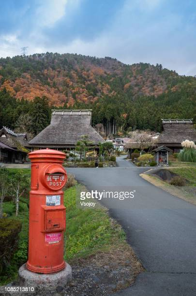 the signature postbox at miyama village, kyoto, japan - vsojoy stockfoto's en -beelden