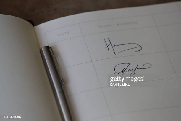 The signatures of Britain's Prince Harry, Duke of Sussex and Meghan, Duchess of Sussex are seen in the visitors book at Edes House in Chichester,...