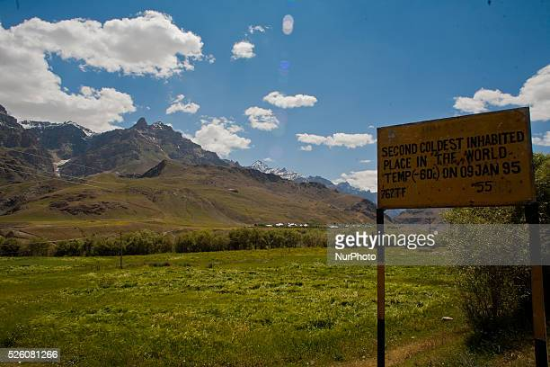 The signboard erected by the authorities on a road next to the wheat field on July 30 2015 in Drass 142 km east of Srinagar the summer capital of...