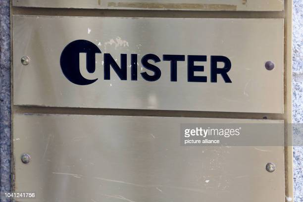 The signboard of Unister hangs next to the entrance to the company headquarters in Leipzig Germany 18 July 2016 The Leipziger internet company...
