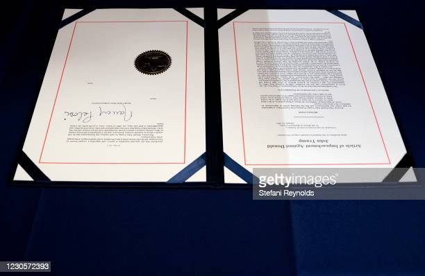 The signed article of impeachment against President Donald Trump sits on a table at the U.S. Capitol on January 13, 2021 in Washington, DC. The House...
