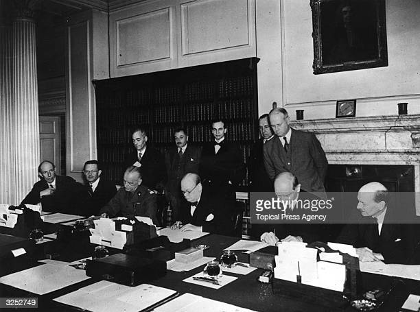 The signing of the agreement between Poland and Great Britain Seated at the table are Polish Ambassador Count Edward Raczynski Polish Prime Minister...