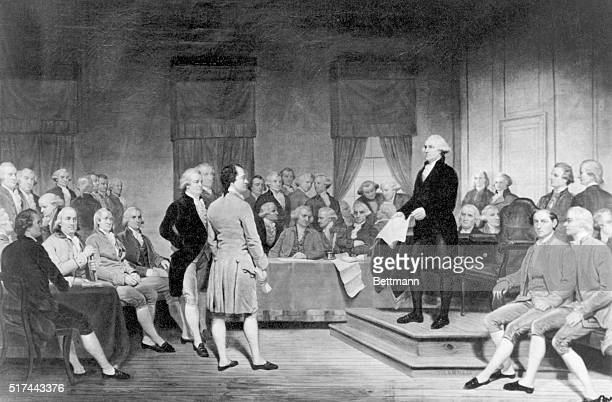 The signing of the Constitution of the United States in 1787 From a painting George Washington is standing on a platform holding a copy of the...