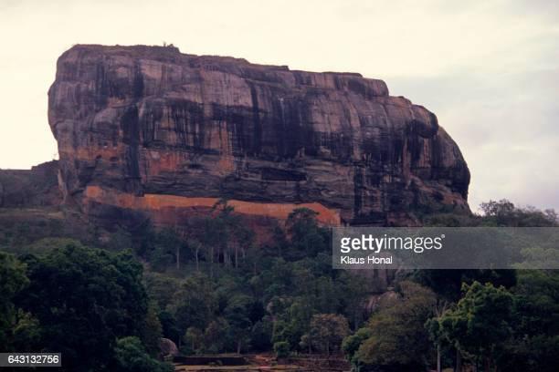 The 'Siha Giri' monolith or lion's rock of Sigiriya, where the ruins of a historic rock fortress and the impressive frescoes of the cloud girls are located - Sigiriya/Sri Lanka