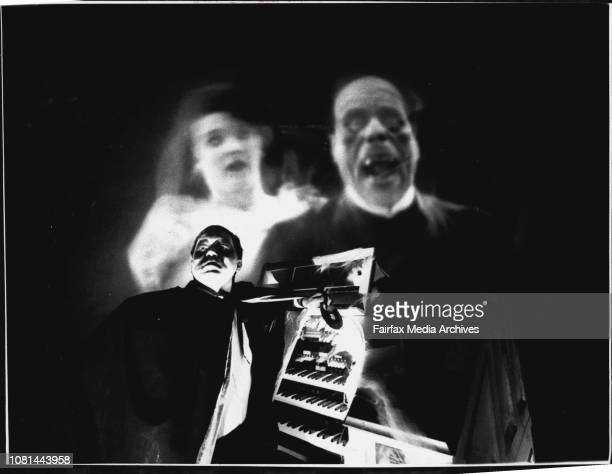 The Silent movie 'Phantom of the opera' to be show with live organ music accompaniment.Organ player Neil Jensen at his organ with a scene of the...