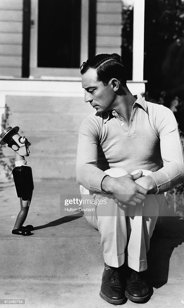 The silent-film star, Buster Keaton, with a wooden doll of himself, ca. 1928.