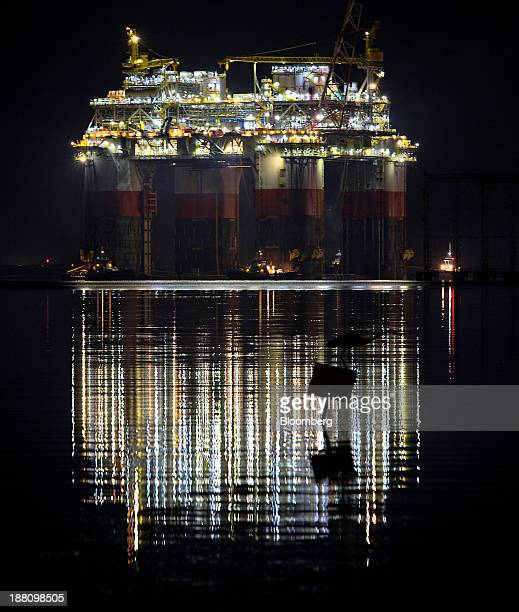 The silhouette of a bird is seen as tug boats transport the Chevron Corp Jack St Malo semisubmersible drilling and production platform to the Gulf of...