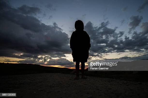 The silhouette of a child is captured on July 20 2016 in Porumbenii Mari Romania