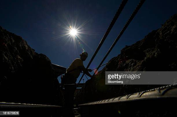 The silhouette of a contractor setting rebar is seen at Lennar Corp's The Shipyard housing project under construction in San Francisco California US...