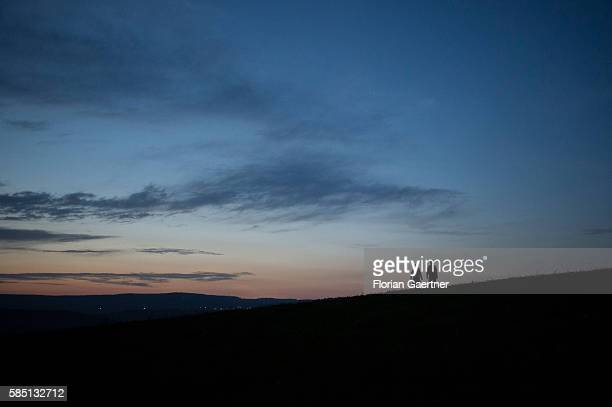 The silhouette of a couple is captured in front of the evening light on July 16 2016 in Odorheiu Secuiesc Romania