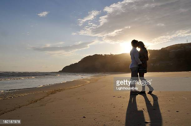 The silhouette of a couple on the beach at sunset