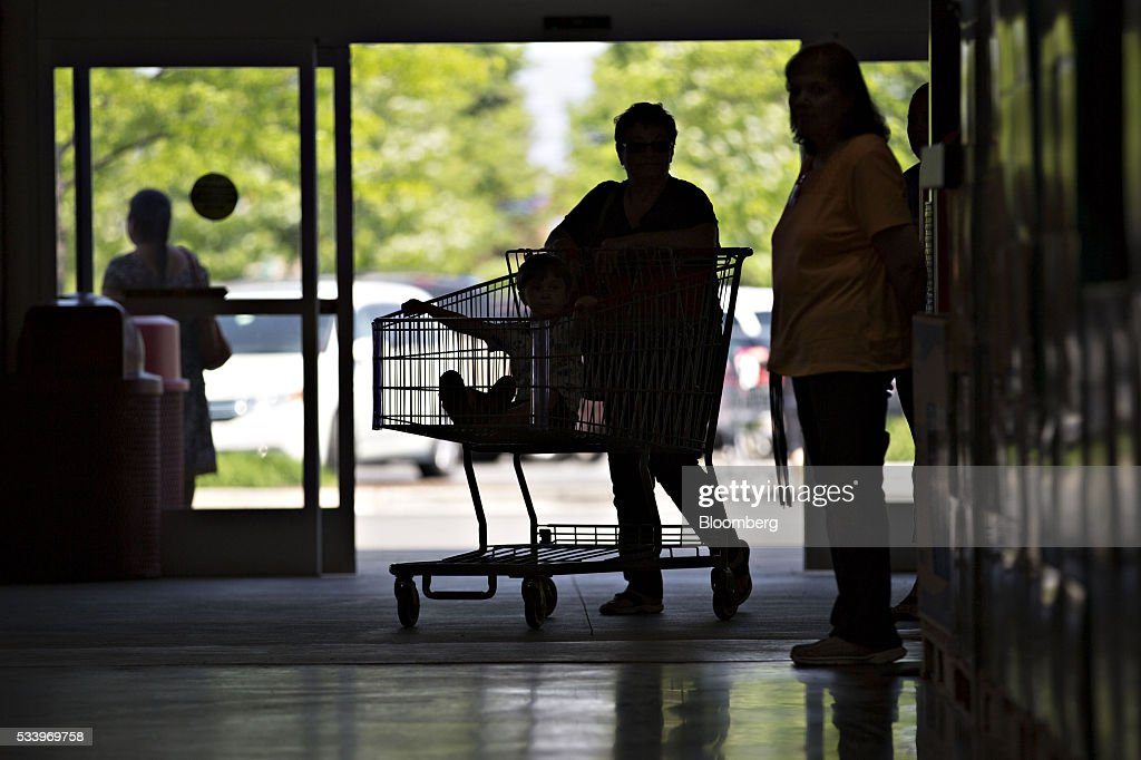 Inside a costco wholesale corp store ahead of earnings figures the silhouette of a customer is seen pushing a cart at a costco wholesale corp thecheapjerseys Gallery