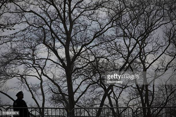 The silhouette of a New York City Police Department officer stands prior to the start of a campaign event for Senator Bernie Sanders an independent...