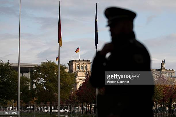 The silhouette of a police officer is captured before meeting of the Normandy Contact Group on October 19 2016 in Berlin Germany The Head of States...