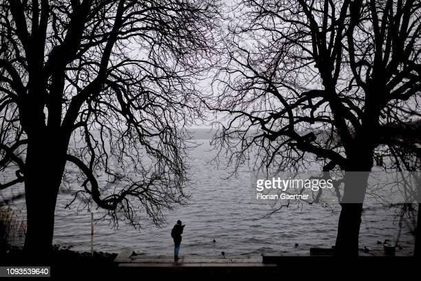 The silhouette of a woman is pictured in front of the lake Wannsee on February 03 2019 in Berlin Germany