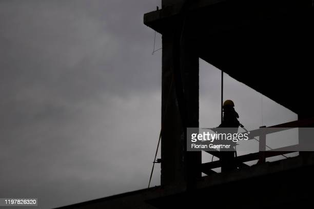 The silhouette of a worker is pictured on January 31 2020 in Berlin Germany