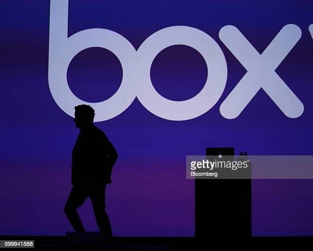 The silhouette of Aaron Levie, chief executive officer and co-founder of Box Inc., is seen on stage during the BoxWorks 2016 Conference at the...