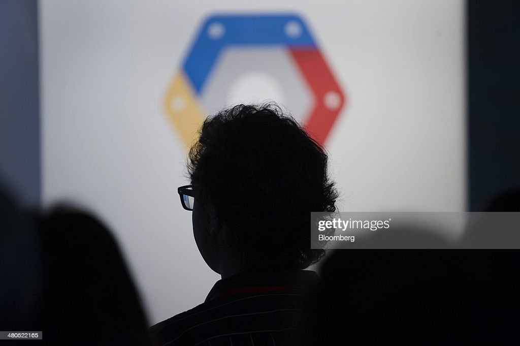 The silhouette of an attendee is seen listening to Urs Holzle, vice president of Operations for Google Inc., not pictured, speak during a Google Inc. Cloud event in San Francisco, California, U.S., on Thursday, March 25, 2014. Google Inc. cut prices on some Internet-based services for businesses by 30 percent or more, stepping up a challenge to Amazon.com Inc. and Microsoft Corp. in cloud computing. Photographer: David Paul Morris/Bloomberg via Getty Images