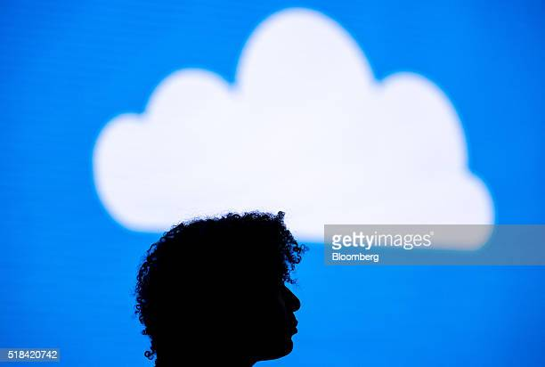 The silhouette of an attendee is seen watching a presentation during a keynote session at the Microsoft Developers Build Conference in San Francisco...