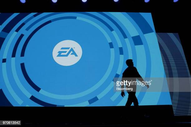 The silhouette of Andrew Wilson chief executive officer of Electronic Arts Inc is seen walking off stage during the company's EA Play event ahead of...