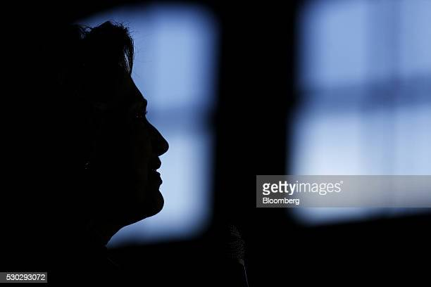 The silhouette of Hillary Clinton former Secretary of State and 2016 Democratic presidential candidate is seen during a campaign event in Louisville...