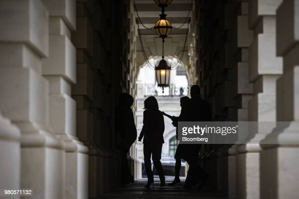 The silhouette of House Minority Leader Nancy Pelosi a Democrat from California center is seen departing after speaking during a news conference on...