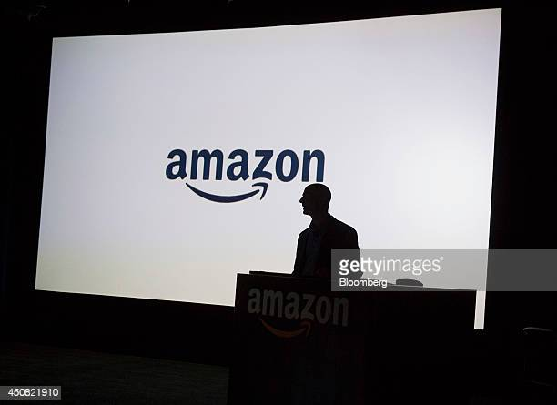The silhouette of Jeff Bezos chief executive officer of Amazoncom Inc is seen as he unveils the Fire Phone during an event at Fremont Studios in...