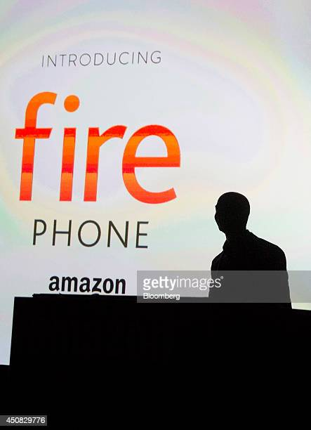 The silhouette of Jeff Bezos chief executive officer of Amazoncom Inc is seen after he unveils the Fire Phone during an event at Fremont Studios in...