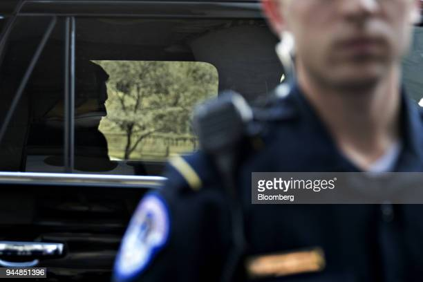 The silhouette of Mark Zuckerberg chief executive officer and founder of Facebook Inc left is seen inside a vehicle following a House Energy and...