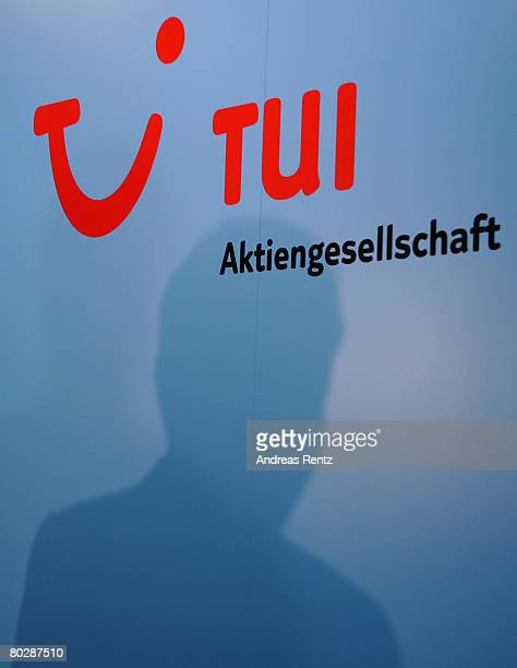 The silhouette of Michael Frenzel, chairman of German tourism, travel and shipping group giant TUI AG seen prior to the annual press conference on...