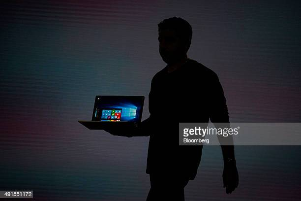 The silhouette of Panos Panay, corporate vice president of Microsoft Corp. Surface, is seen as he unveils the new Microsoft Surface Book laptop...