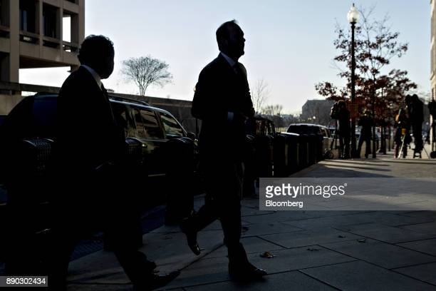 The silhouette of Rick Gates former deputy campaign manager for Donald Trump center is seen as he arrives at the US Courthouse for a status...