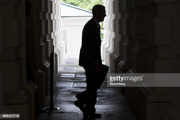 The silhouette of Robert Mueller former director of the Federal Bureau of Investigation and special counsel for the US Department of Justice is seen...